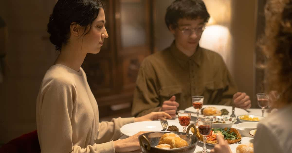 A man and a woman sitting at a table with food