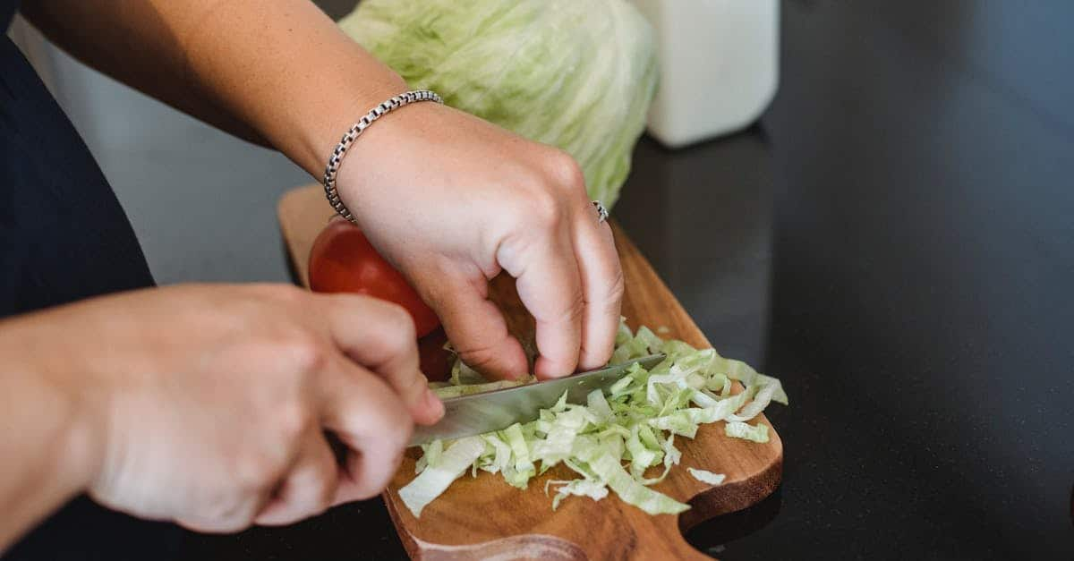 A close up of a person cutting into a sandwich